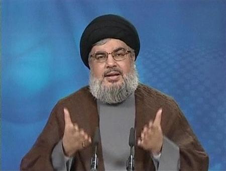 Hezbollah leader Sayyed Hassan Nasrallah gestures as he speaks during a live broadcast in this still image taken from video, June 24, 2011. REUTERS/Manar TV via Reuters Tv