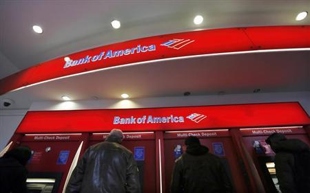 Customers use ATMs at a Bank of America banking center in New York's financial district January 17, 2013. REUTERS/Brendan McDermid