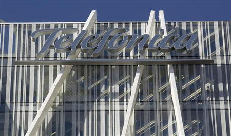 Telefonica's logo is seen on top of Telefonica's tower in Barcelona January 31, 2013. REUTERS/Albert Gea
