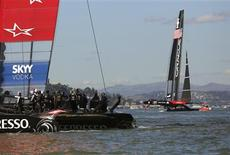 Oracle Team USA (R) sails ahead of Emirates Team New Zealand during Race 16 of the 34th America's Cup yacht sailing race in San Francisco, California September 23, 2013. REUTERS/Robert Galbraith