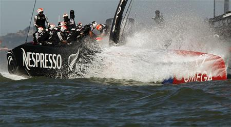 Emirates Team New Zealand sails against Oracle Team USA during Race 16 of the 34th America's Cup yacht sailing race in San Francisco, California September 23, 2013. REUTERS/Robert Galbraith