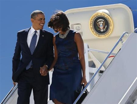 U.S. President Barack Obama and first lady Michelle Obama arrive in New York, where Obama will attend the United Nations General Assembly September 23, 2013. REUTERS/Kevin Lamarque