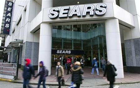 People walk past the main Sears store in downtown Vancouver, British Columbia February 23, 2011. Retailer Sears Canada Inc posted a 28 percent drop in its quarterly profit, hurt in part by lower demand for appliances. REUTERS/Andy Clark