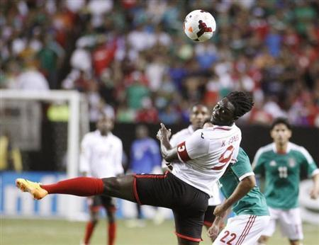 Trinidad & Tobago's Kenwyne Jones heads a ball down the field during play against Mexico in the first half during their CONCACAF Gold Cup soccer game in Atlanta, Georgia July 20, 2013. REUTERS/Tami Chappell