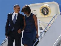 Barack Obama a dit, en marge de l'assemblée générale de l'Onu à New York, avoir arrêté de fumer par peur de sa femme Michelle, ignorant qu'un micro était resté ouvert. /Photo prise le 23 septembre 2013/REUTERS/Kevin Lamarque