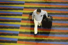 A passenger walks at the Simon Bolivar airport in La Guaira, outside Caracas September 23, 2013. REUTERS/Carlos Garcia Rawlins