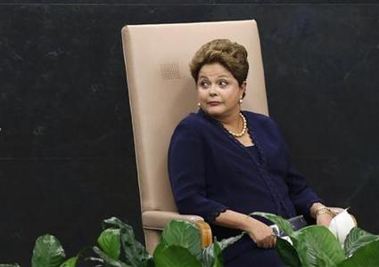 Brazil's President Dilma Rousseff reacts to someone offstage as she waits to address the 68th United Nations General Assembly at U.N. headquarters in New York, September 24, 2013. REUTERS-Mike Segar