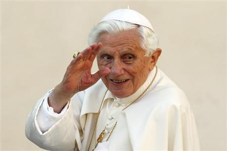 Former Pope Benedict XVI waves as he arrives to lead the Wednesday general audience in Saint Peter's square, at the Vatican in this file phot taken October 24, 2012. REUTERS/Giampiero Sposito