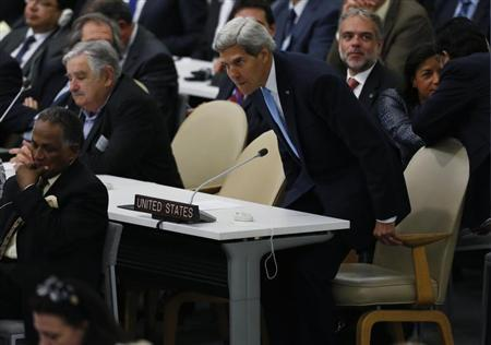 U.S. Secretary of State John Kerry (R) takes his seat during the 68th United Nations General Assembly at UN headquarters in New York, September 24, 2013. REUTERS/Shannon Stapleton