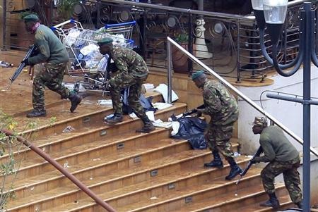 Kenya Defence Forces soldiers take their position at the Westgate shopping centre, on the fourth day since militants stormed into the mall, in Nairobi September 24, 2013. REUTERS/Noor Khamis