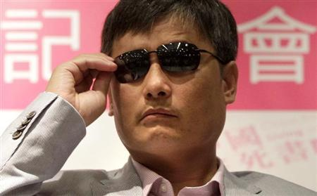 Chinese dissident Chen Guangcheng attends the book release event for ''China, the Book of Living and Dying'' in Taipei June 27, 2013. REUTERS/Pichi Chuang