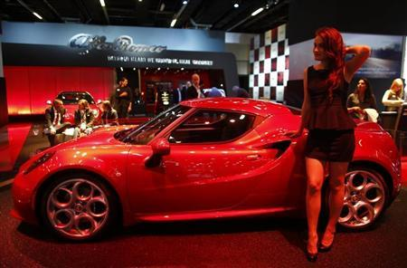 A model stands next to a Alfa Romeo 4C during a media preview day at the Frankfurt Motor Show (IAA) September 10, 2013. REUTERS/Pawel Kopczynski