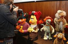 A news photographer shoots puppets from Sesame Street and Muppets fame after they were donated to the Smithsonian's National Museum of American History in Washington September 24, 2013. REUTERS/Larry Downing