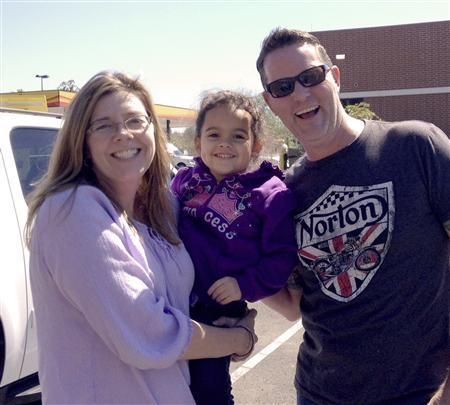 Four-year-old Veronica, is shown with her adoptive parents, Melanie and Matt Capobianco after being reunited at an undisclosed location September 23, 2013 in this handout provided by the Capobianco family September 24, 2013. REUTERS/Capobianco Family/Handout via Reuters