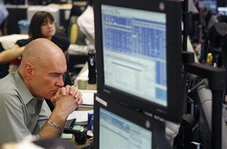 A broker waits for a phone call as he trades on the dealing floor at ICAP in Jersey City, New Jersey December 9, 2009. REUTERS/Lucas Jackson