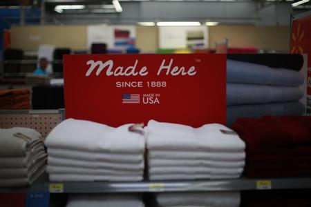 A stack of shirts are seen on display at a Walmart Supercenter in Rogers, Arkansas June 6, 2013. REUTERS/Rick Wilking