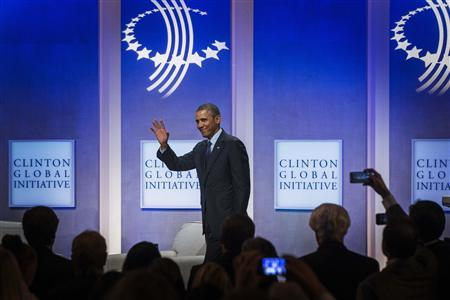 U.S. President Barack Obama waves as he departs after a discussion about healthcare at the Clinton Global Initiative (CGI) in New York September 24, 2013. REUTERS/Lucas Jackson