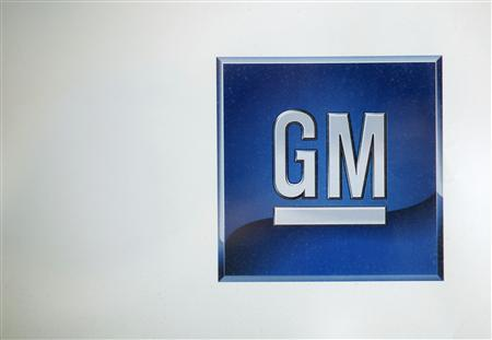 A logo at a GM dealership is seen in New York May 15, 2009. More than 100,000 jobs are at risk from the unprecedented GM and Chrysler dealership closures in the U.S., showing the spreading economic pain from the collapse of the two automakers. REUTERS/Eric Thayer