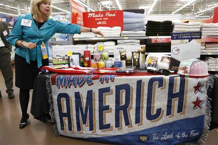 Michelle Gloeckler, senior vice-president of the home division at Wal-Mart Stores Inc, shows off a selection of merchandise made in the U.S. for sale at a Walmart Supercenter in Rogers, Arkansas in this June 6, 2013 file photo. REUTERS/Rick Wilking/Files