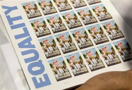 A page of U.S. Postal Service limited-edition stamps commemorating the 1963 'March on Washington for Jobs and Freedom'' is displayed in Washington August 23, 2013. REUTERS/Joshua Roberts