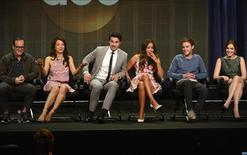 "From L-R: Cast members Clark Gregg, Ming-Na Wen, Brett Dalton, Chloe Bennet, Iain De Caestecker and Elizabeth Henstridge participate in a panel for ""Marvel's Agents of S.H.I.E.L.D."" during the Disney ABC Television Group sessions at the Television Critics Association summer press tour in Beverly Hills, California August 4, 2013. REUTERS/Phil McCarten"