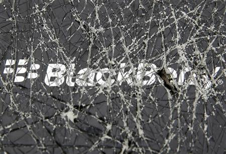 A Blackberry logo is seen through a cracked box in this photo illustration taken in the central Bosnian town of Zenica, September 24, 2013. Smartphone maker BlackBerry has agreed to go private in a $4.7 billion deal led by its biggest shareholder, allowing the on-the-go email pioneer to regroup away from public scrutiny after years of falling fortunes and slumping market share. REUTERS/Dado Ruvic