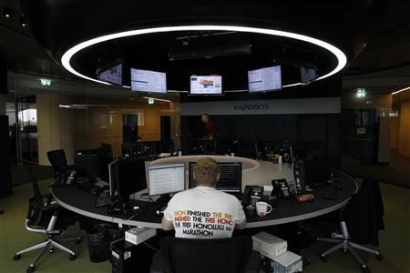 An employee works near screens in the virus lab at the headquarters of Russian cyber security company Kaspersky Labs in Moscow in this July 29, 2013 file photo. REUTERS/Sergei Karpukhin/Files