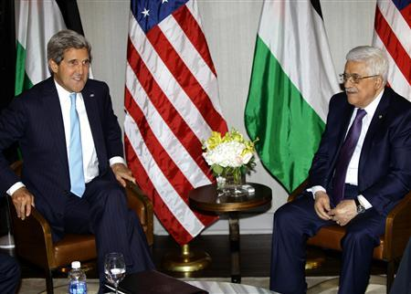 Secretary of State John Kerry speaks with Palestinian Authority President Mahmoud Abbas during the United Nations General Assembly at the Hyatt Hotel in New York September 24, 2013. REUTERS/Joshua Lott