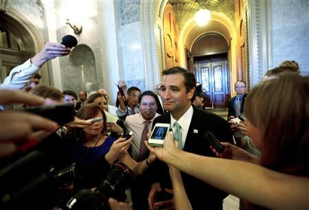U.S. Senator Ted Cruz (R-TX) speaks to the press after leaving the Senate Chamber after a marathon attack on ''Obamacare,'' at the U.S. Capitol in Washington, September 25, 2013. REUTERS/Jason Reed