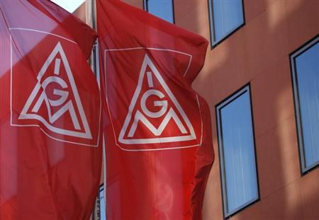 Flags of Germany's metalworkers' union IG Metall (IGM) are pictured past the IGM headquarters in Frankfurt May 3, 2012. REUTERS/Ralph Orlowski