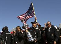 Skipper James Spithill celebrates with the America's Cup with members of the Oracle Team USA after winning the overall title of the 34th America's Cup yacht sailing race over Emirates Team New Zealand in San Francisco, California September 25, 2013. REUTERS/Robert Galbraith