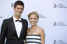 Serbian tennis player Novak Djokovic and his girlfriend Jelena Ristic pose for photographers as they arrive at a fundraising dinner for the Novak Djokovic Foundation in London July 8, 2013 in this file picture. REUTERS/Neil Hall