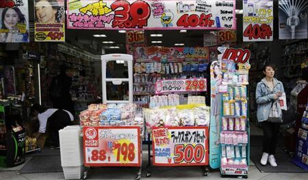 A woman walks out of a drugstore in Tokyo April 25, 2013. REUTERS/Toru Hanai