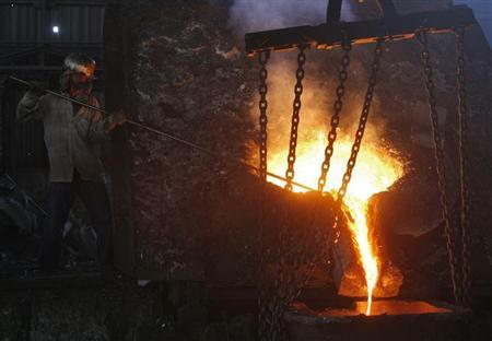 A labourer works inside a steel factory on the outskirts of Jammu June 12, 2012. REUTERS/Mukesh Gupta/Files