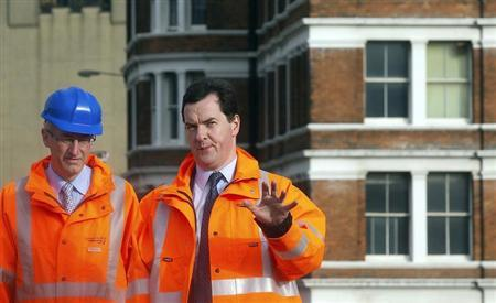 Britain's Chancellor of the Exchequer George Osborne (R) talks to David Higgins, Chief Executive Officer of Network Rail during a visit to a development at Blackfriars in central London November 1, 2011. REUTERS/Simon Dawson/Pool