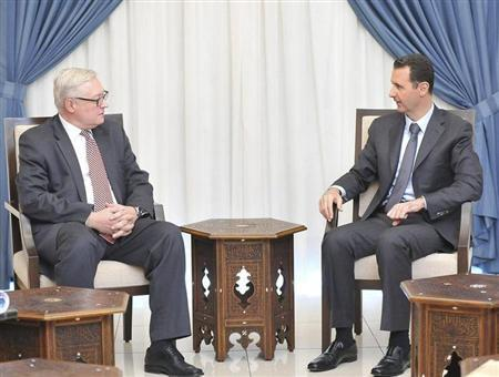 Syria's President Bashar al-Assad (R) meets Russian deputy Foreign Minister Sergei Ryabkov in Damascus, in this handout photograph distributed by Syria's national news agency SANA on September 18, 2013. REUTERS/SANA/Handout via Reuters