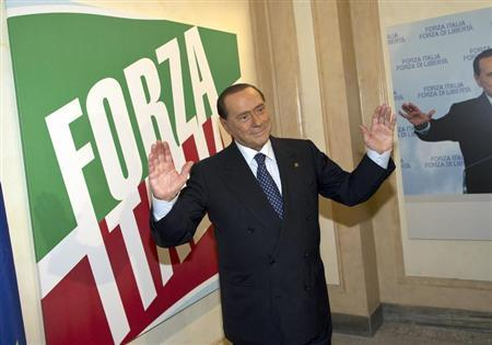 Former Italian leader Silvio Berlusconi stands inside the new headquarters of his re-launched original political party, Forza Italia (Go Italy), in downtown Rome September 19, 2013. REUTERS/Massimo Percossi/Pool