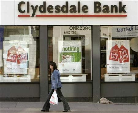 A woman walks past a Clydesdale Bank in Glasgow, May 11, 2005.
