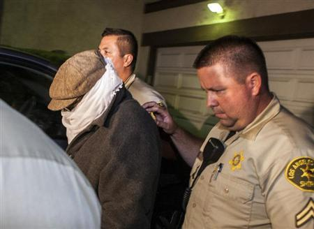 Nakoula Basseley Nakoula (L) is escorted out of his home by Los Angeles County Sheriff's officers in Cerritos, California September 15, 2012. REUTERS/Bret Hartman/Files