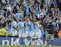Manchester City's Sergio Aguero (16) celebrates with teamates after scoring against Manchester United during their English Premier League soccer match at The Etihad Stadium in Manchester, northern England, September 22, 2013. REUTERS/Phil Noble