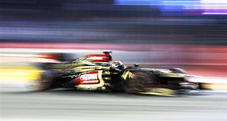 Lotus F1 Formula One driver Kimi Raikkonen of Finland races during the Singapore F1 Grand Prix at the Marina Bay street circuit in Singapore September 22, 2013. REUTERS/Edgar Su
