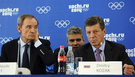 Jean-Claude Killy (L), head of the IOC Coordination Commission to monitor progress for the Sochi 2014 Winter Olympics, and Russia's Deputy Prime Minister Dmitry Kozak (R) attend a news conference on the results of the 10th visit of the IOC Coordination Commission in Sochi, September 26, 2013. REUTERS/Nina Zotina