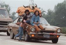 "Unidentified American Indian youths ride a car adorned with a buffalo skull as the ""Longest Walk"" approaches Washington in this July 1978 handout photo. REUTERS/Dick Bancroft/Handout via Reuters"