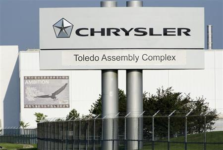 The Chrysler Toledo Assembly Complex has features banners (here Ambition) on the outside of the facility as part of its ''Head, Heart and Hands'' initiative to build community among workers at the plant. The new section of the plant will be used to produce the Jeep Cherokee. Toledo, Ohio July 18, 2013. REUTERS/James Fassinger