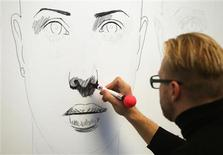 Austrian artist Alex Kiessling creates a drawing in Vienna September 26, 2013. REUTERS/Heinz-Peter Bader