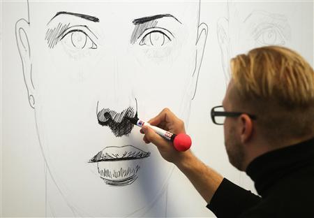 Austrian artist Alex Kiessling creates a drawing in Vienna September 26, 2013. REUTERS/Heinz-Peter Bader