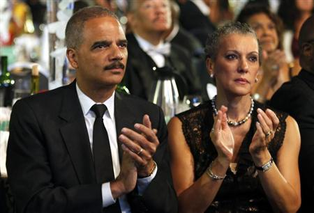 U.S. Attorney General Eric Holder and his wife Sharon Malone attend the Congressional Black Caucus Foundation Annual Phoenix Awards Dinner in Washington, September 21, 2013. REUTERS/Yuri Gripas