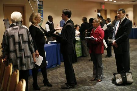Job seekers wait to meet with employers at a career fair in New York City, October 24, 2012. REUTERS/Mike Segar