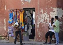 A woman walks beside a private shop in Havana September 26, 2013. REUTERS/Desmond Boylan (CUBA - Tags: POLITICS BUSINESS)