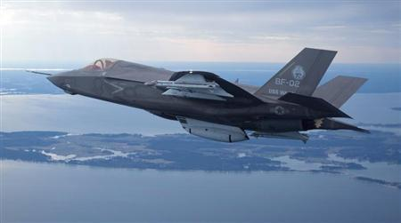 The U.S. Marine Corps version of Lockheed Martin's F35 Joint Strike Fighter, F-35B test aircraft BF-2 flies with external weapons for the first time over the Atlantic test range at Patuxent River Naval Air Systems Command in Maryland in a February 22, 2012 file photo. REUTERS/Lockheed Martin/Handout